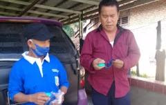 Jajaran Aparatur Kampung Banjar Masin Lakukan Penyemprotan Disinfektan